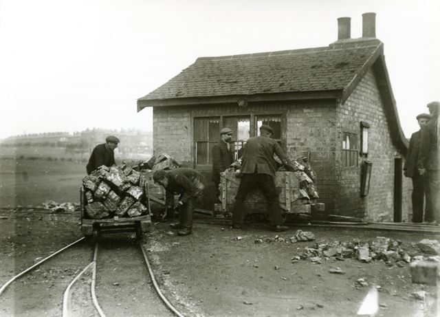 Radford Colliery. Miners manouvering wagons of coal near the pit-top.