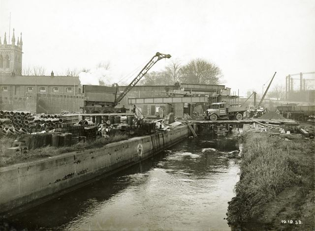 Bridge pier building over the River Leen during the development of Western Boulevard