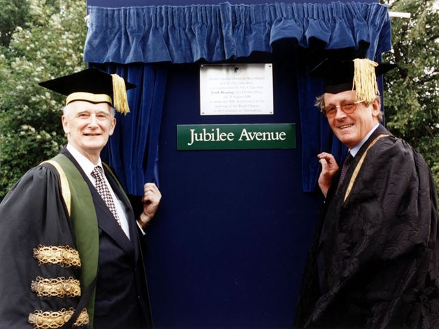 Lord Dearing (L) and Vice Chancellor Sir Colin Campbell unveil a plaque for the Golden Jubilee of th