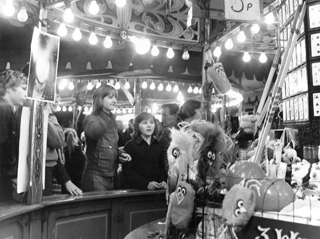 Goose Fair - Teenagers at a darts stall sideshow
