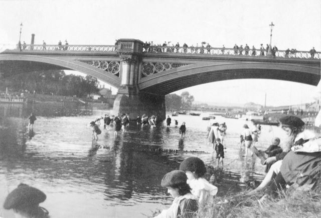 Children playing in the river Trent at Trent Bridge