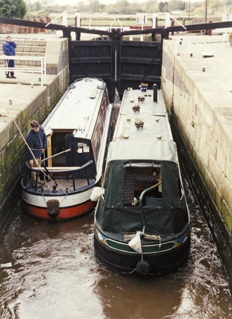 Narrowboats passing through Beeston Canal Lock at the junction with the River Trent