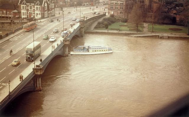 Boat stuck under Trent Bridge in the floods