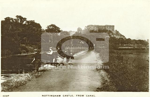 Boys fishing on the Nottingham Canal, next to Castle Boulevard looking towards Nottingham Castle
