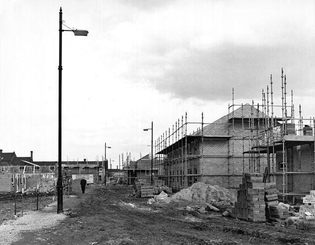 The re-building of the Meadows (note the old lamp posts which remained from the old street layout)