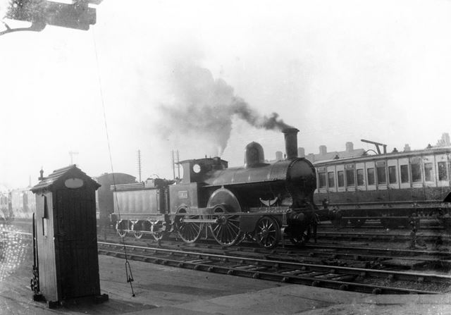 A (Victorian ?) locomotive no 1214 and train at the London Road Low Level Station