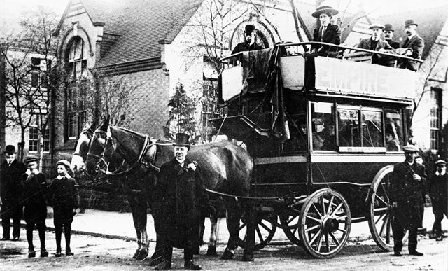 Driver Bertie Wainwright in top hat with his Horse Bus.
