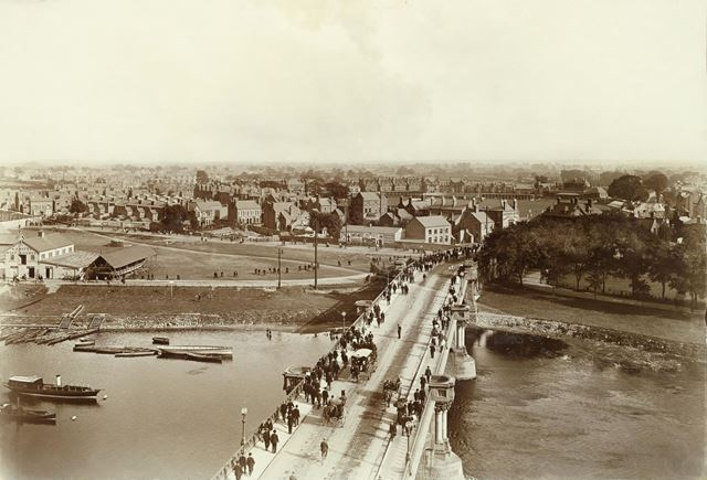 Crowds crossing Trent Bridge, heading to Nottingham Forest Football Club's Ground (centre left)