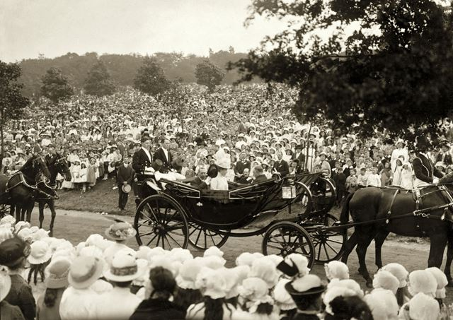 King George V and Queen Mary pass by crowds of schoolchildren on their visit to Nottingham in 1914