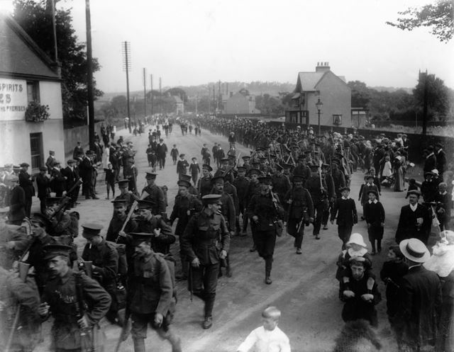 Soldiers of the Sherwood Foresters (?) march past the Rose and Crown. (the date given for this pictu