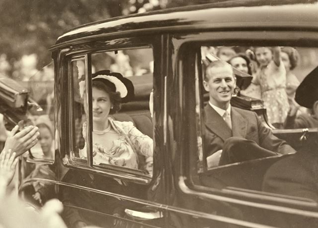 Driving through the streets during the Royal visit of Princess Elizabeth and the Duke of Edinburgh