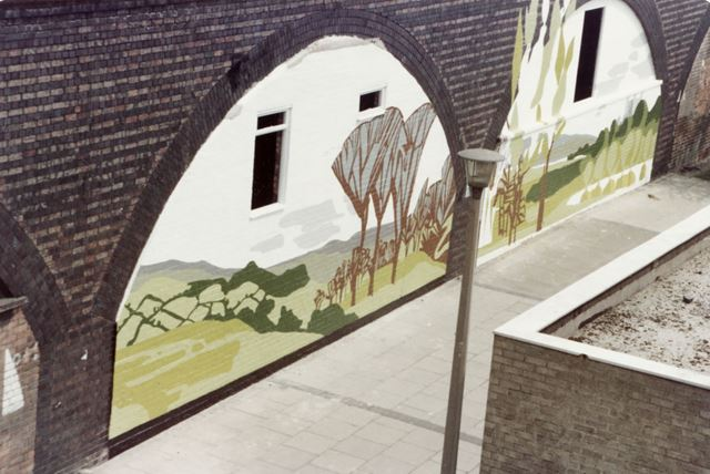 Murals in the brickwork arches of the Weekday Cross Junction viaduct