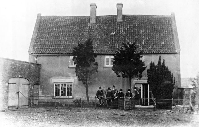 Cottage with family group, Alverton, c 1880
