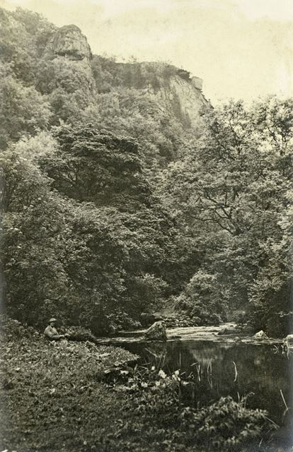 Woman Sitting Next to the River Dove, Dovedale, c 1930s